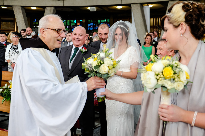 Priest with Bride and Groom
