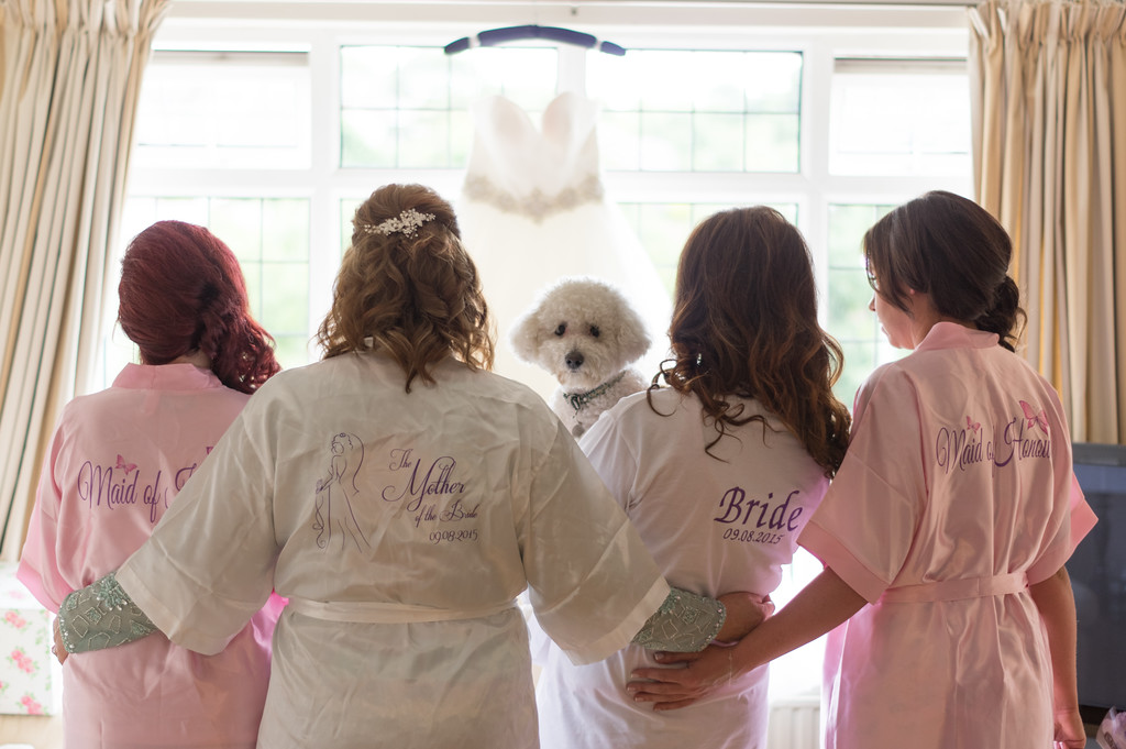 Group shot of Bride , bridesmaids and mother with pooch.