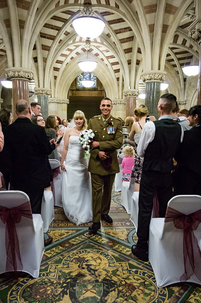 The happy couple walking down the aisle in Rochdale Town Hall.