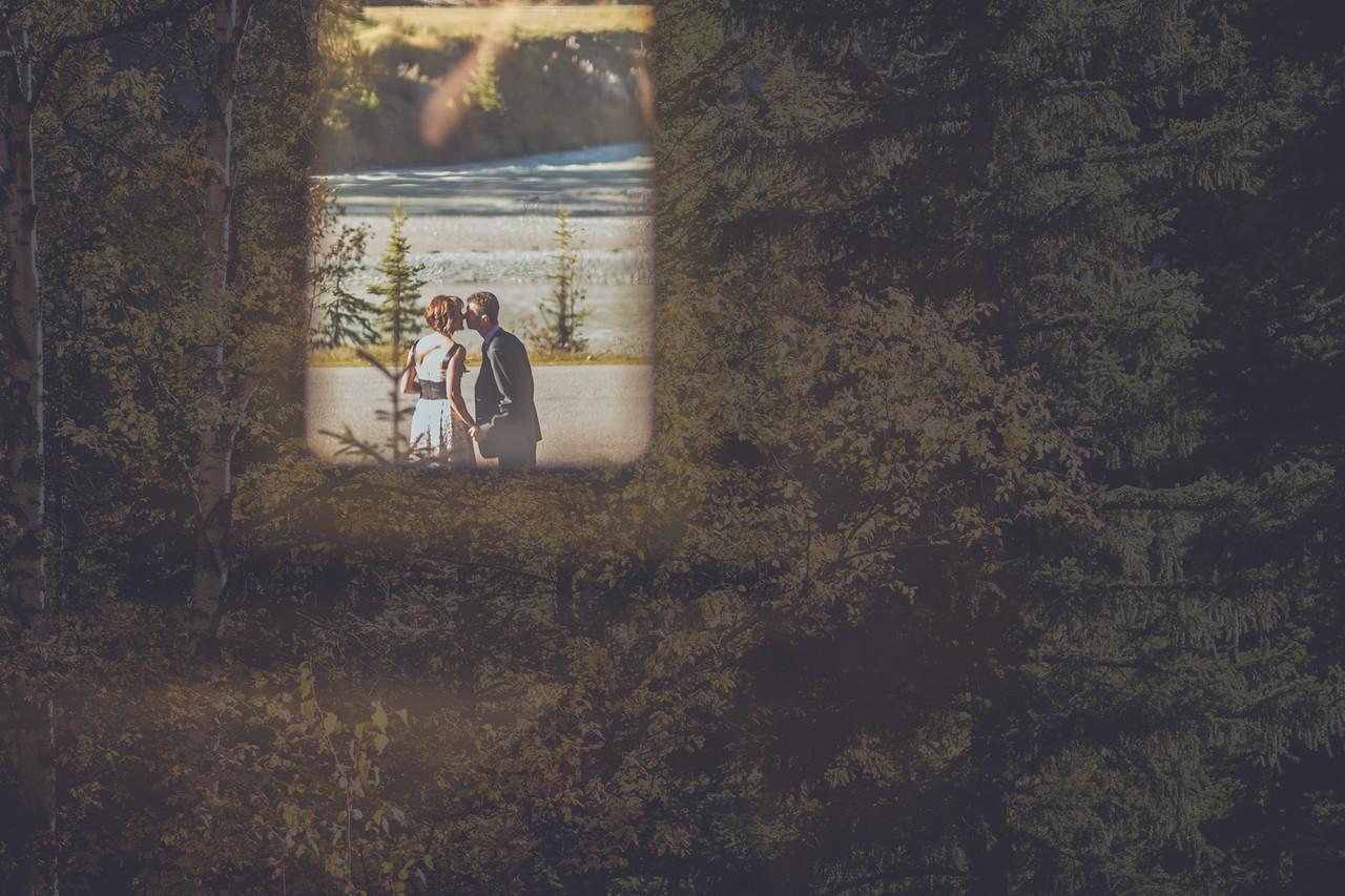 Nuzzling Couple in Tree Window
