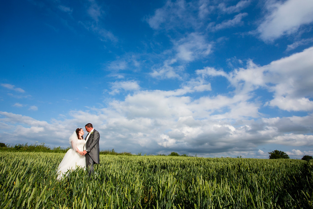 Couple outstanding in their field