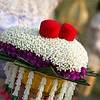 Rings atop fresh flowers.  Thailand Buddhist wedding.