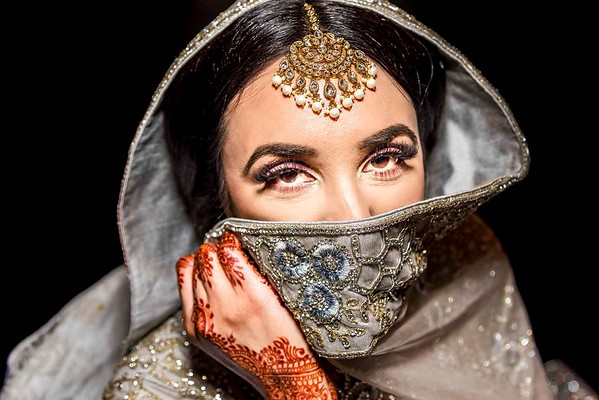 muslim bride covering face