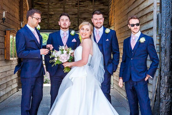 bride with best man and groomsmen