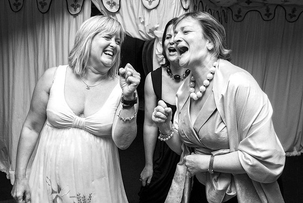 wedding guests sing at wedding reception