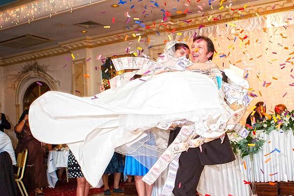 greek groom spinning his greek bride