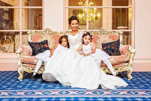 bride with her two flower girls sitting beside her