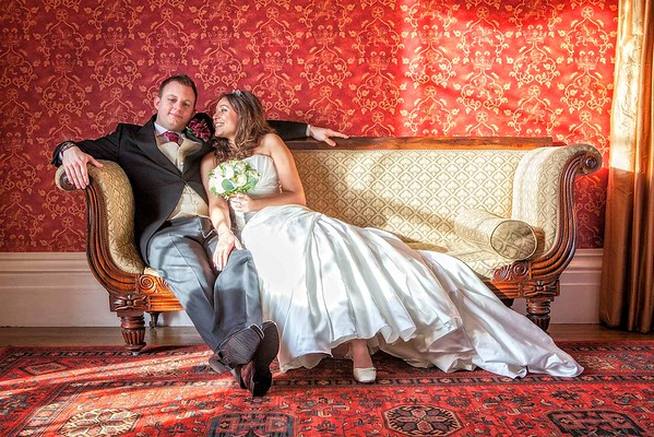 bride and groom sitting on a couch