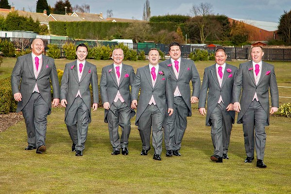 groom best man and groomsmen walking side by side