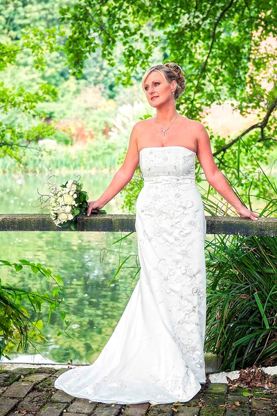 bride standing by lake at leez priory