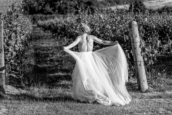 bride walking through vineyard
