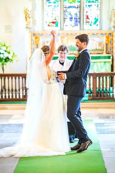 bride cheering at the altar