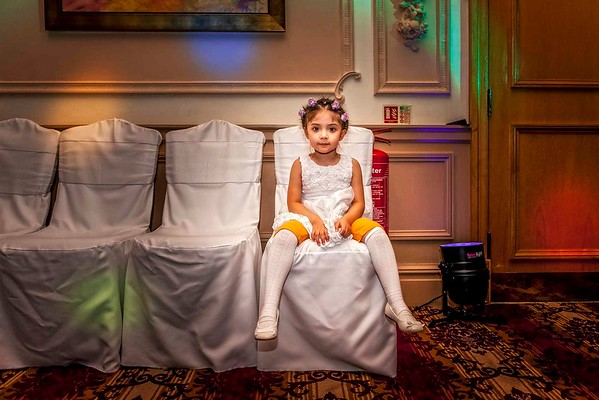 flower girl sitting on chair