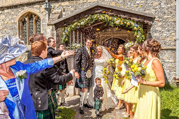 Confetti thrown over bride and groom outside church