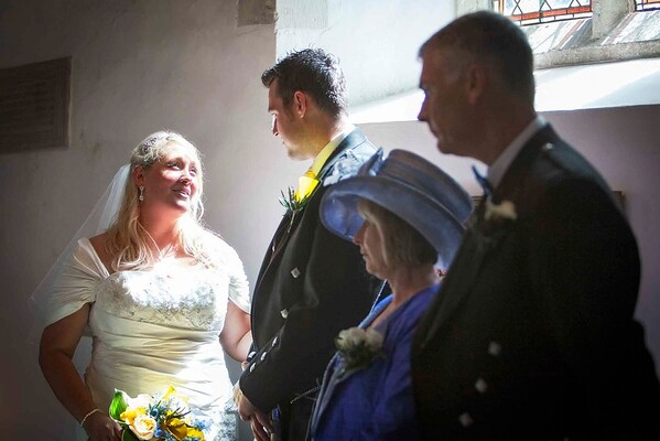 sun shining onto bride at church