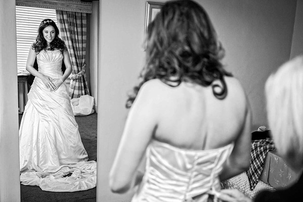 bride getting ready in front of mirror