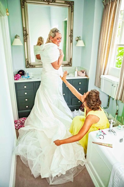 bride getting ready in bathroom