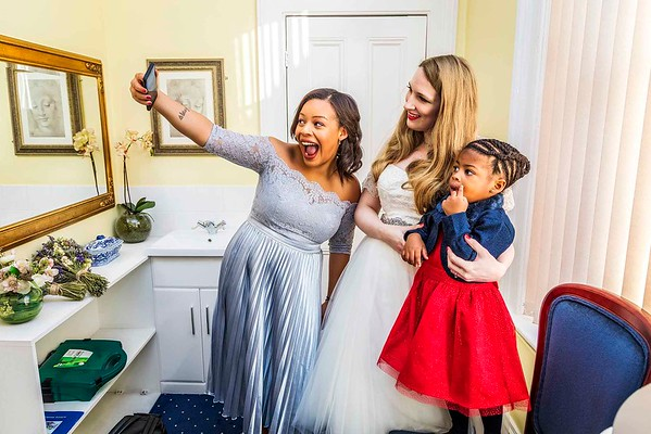 bridesmaid taking a selfie with bride