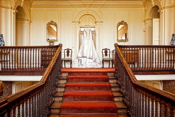 wedding dress hanging from door frame