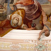 cloak and cherub emeerge from ceiling painting