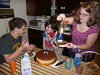Kati helps ready the real Boston Cream Pie for initial assault.