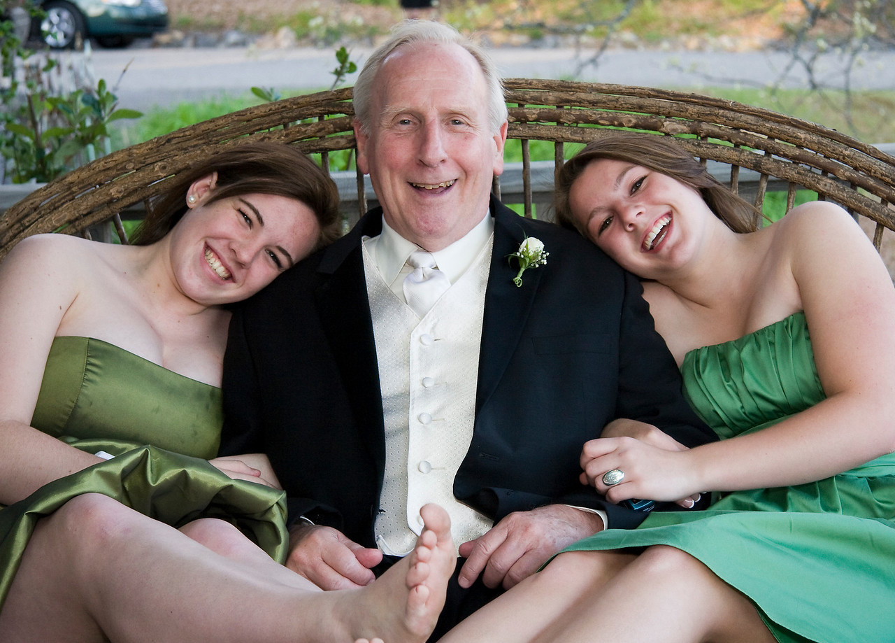 A happy grandfather with his granddaughters
