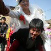 Lianghui's brother must carry his bride to their new home - note the red stockings for good luck