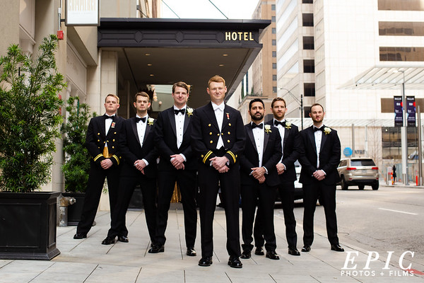 Groomsmen group in front of the Adolphus Hotel