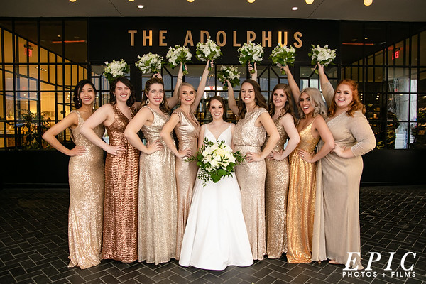 Bridesmaids group in front of the Adolphus Hotel