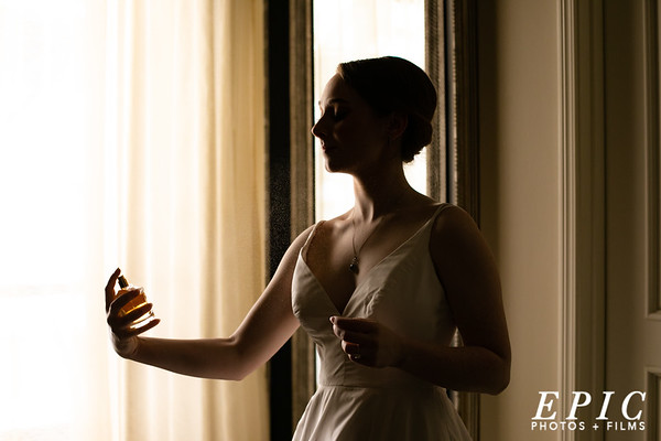 Bride putting on perfume, the final touches on the wedding day at the adolphus hotel