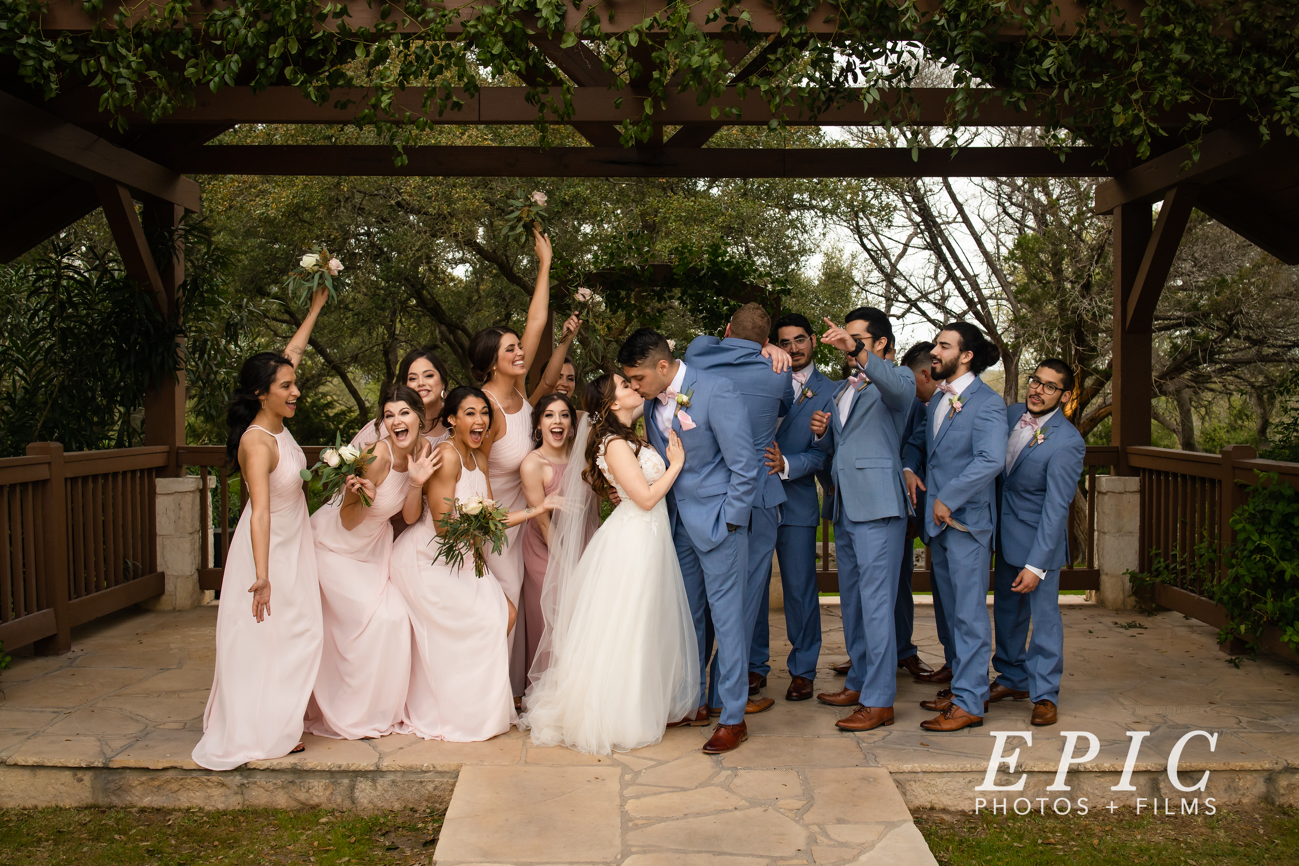 Fun group shot of the bridal party on the wedding day at The Milestone in New Braunfels, Texas