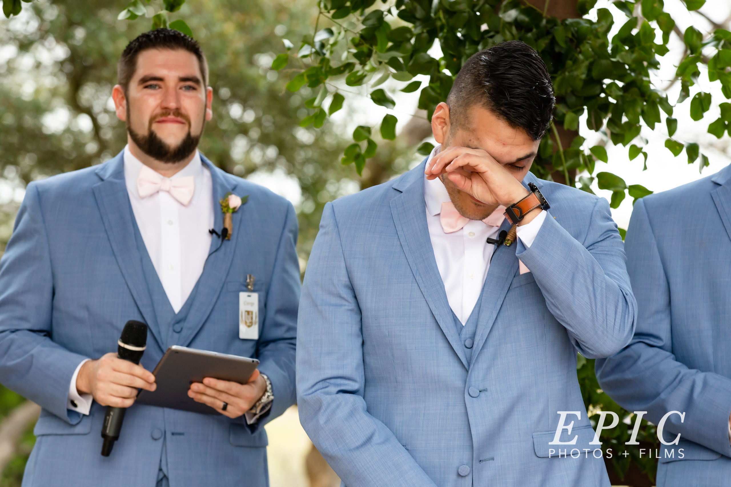 The groom cries happy tears when seeing his bride walking down the aisle