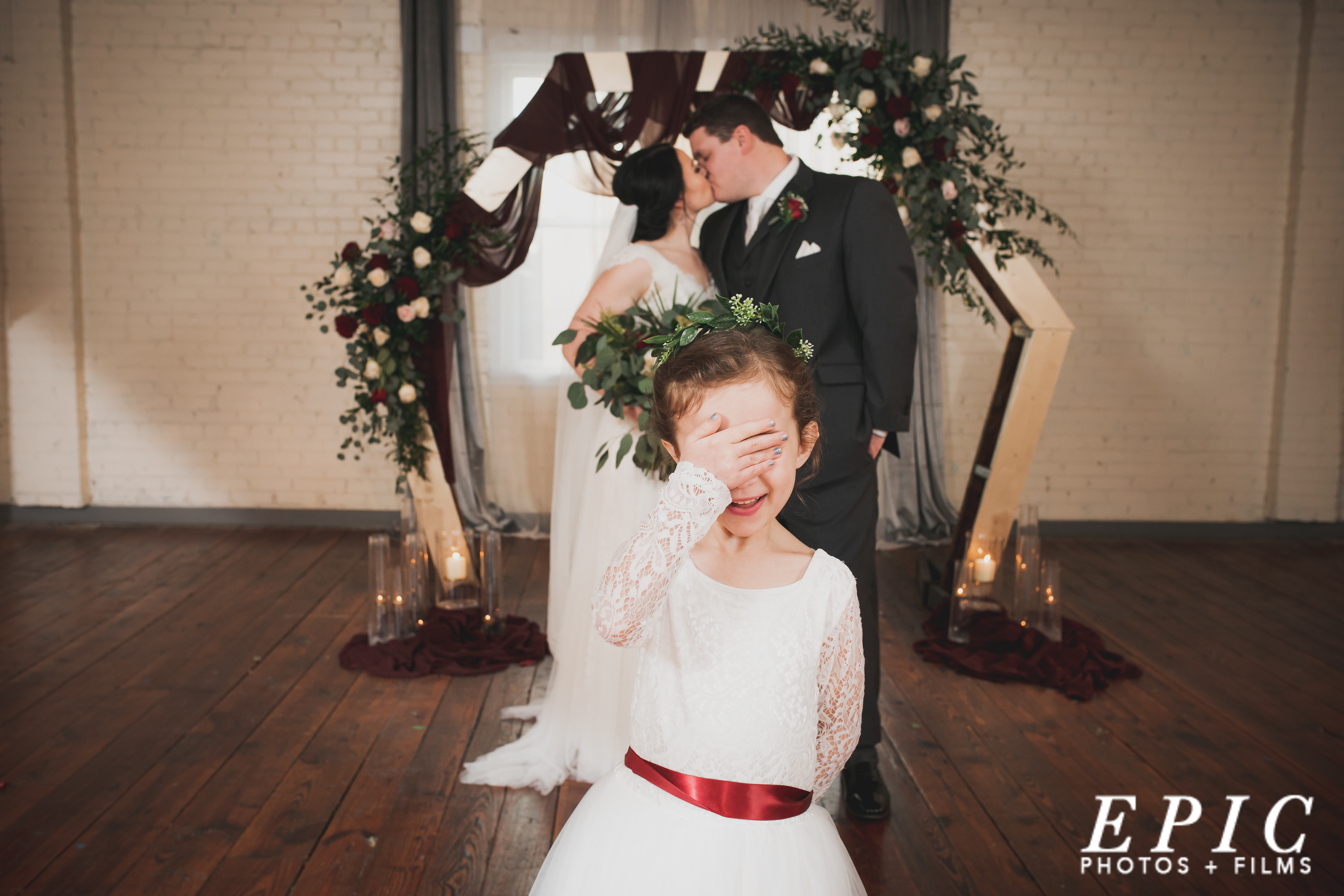 Cute! The flower girl doesn't want to see the bride and groom kissing on their wedding day