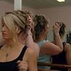 Amy fixing Jessa's hair.