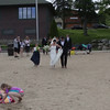 Wedding party strolls the town beach at Lake Placid