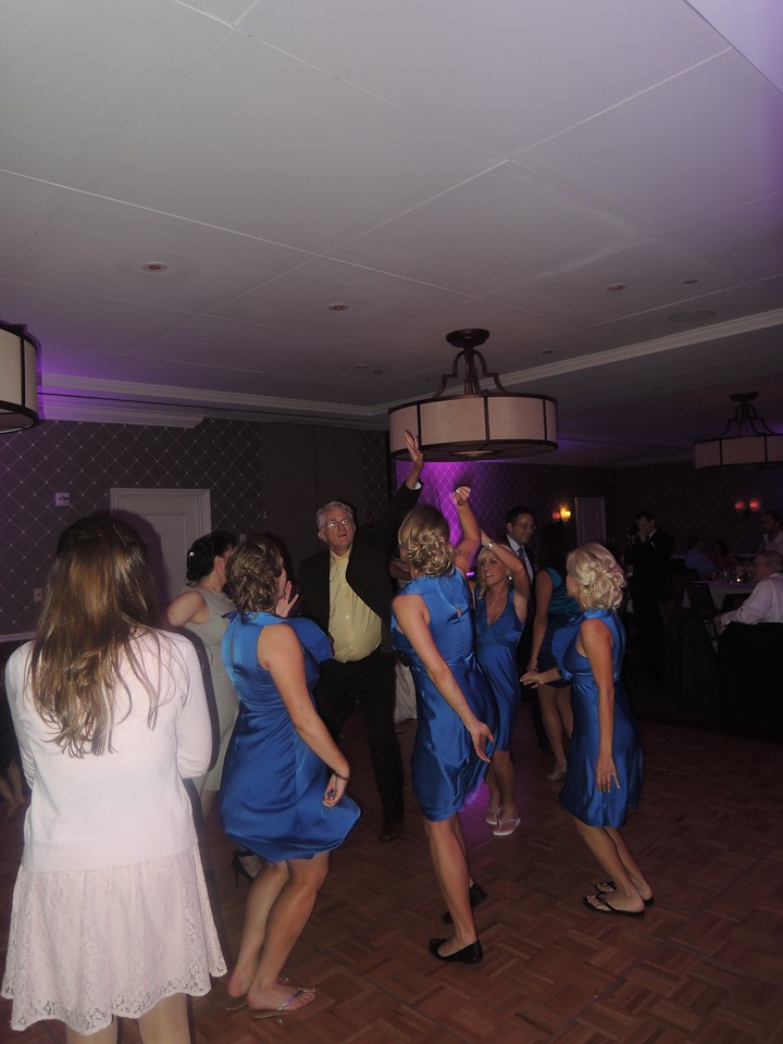 Tom, dancing with the bridesmaids.