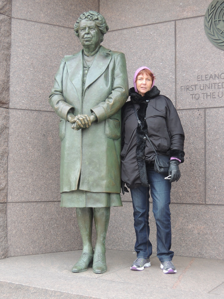 Kathleen next to a larger-than-life statue of a hero of hers, Eleanor Roosevelt.