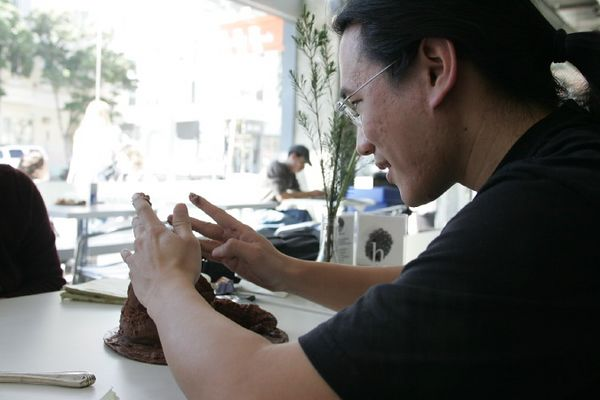 Adam attempts the art of cake-sculpting