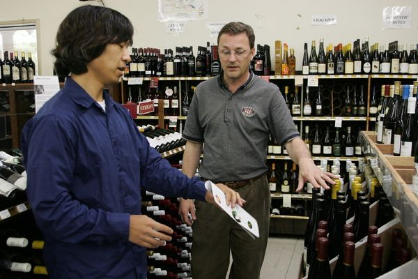 Joon-Mo consults the store sommelier