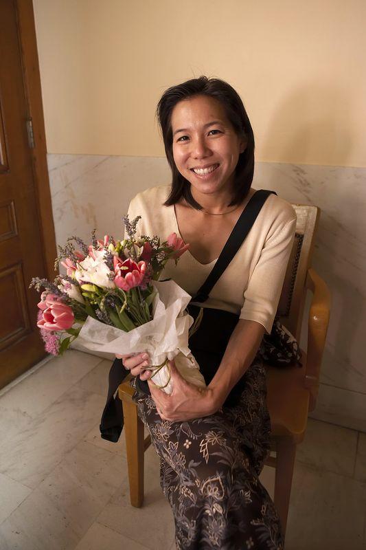 Edna holds the flowers