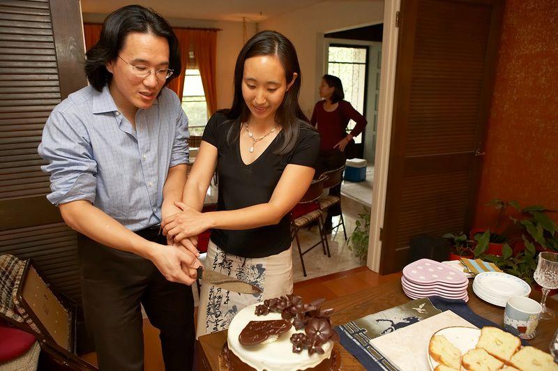 Adam and Rae practice cake cutting