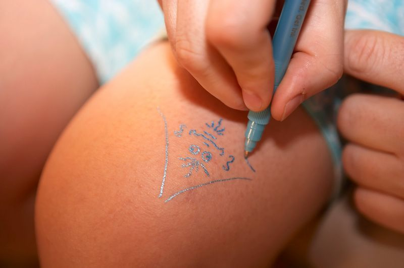 Vienna Teng doodles on her knee