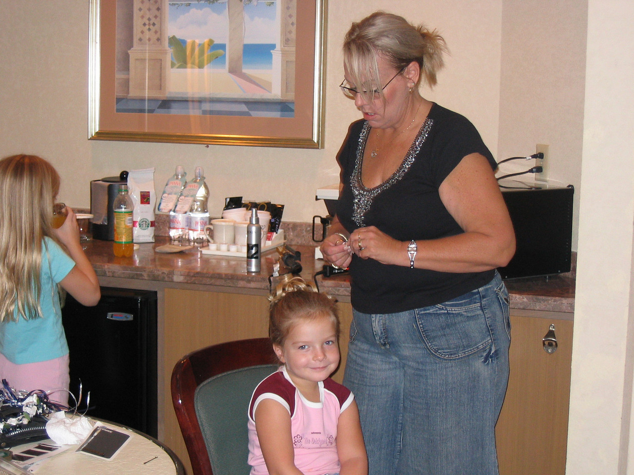 The hairdresser gets the girls ready.