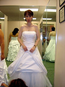 Michele tries on her dress.
