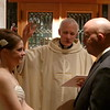 Friday evening, Hudson, WI<br /> Wedding ceremony at Church of St. Patrick<br /> Alicia and Tom receive a blessing