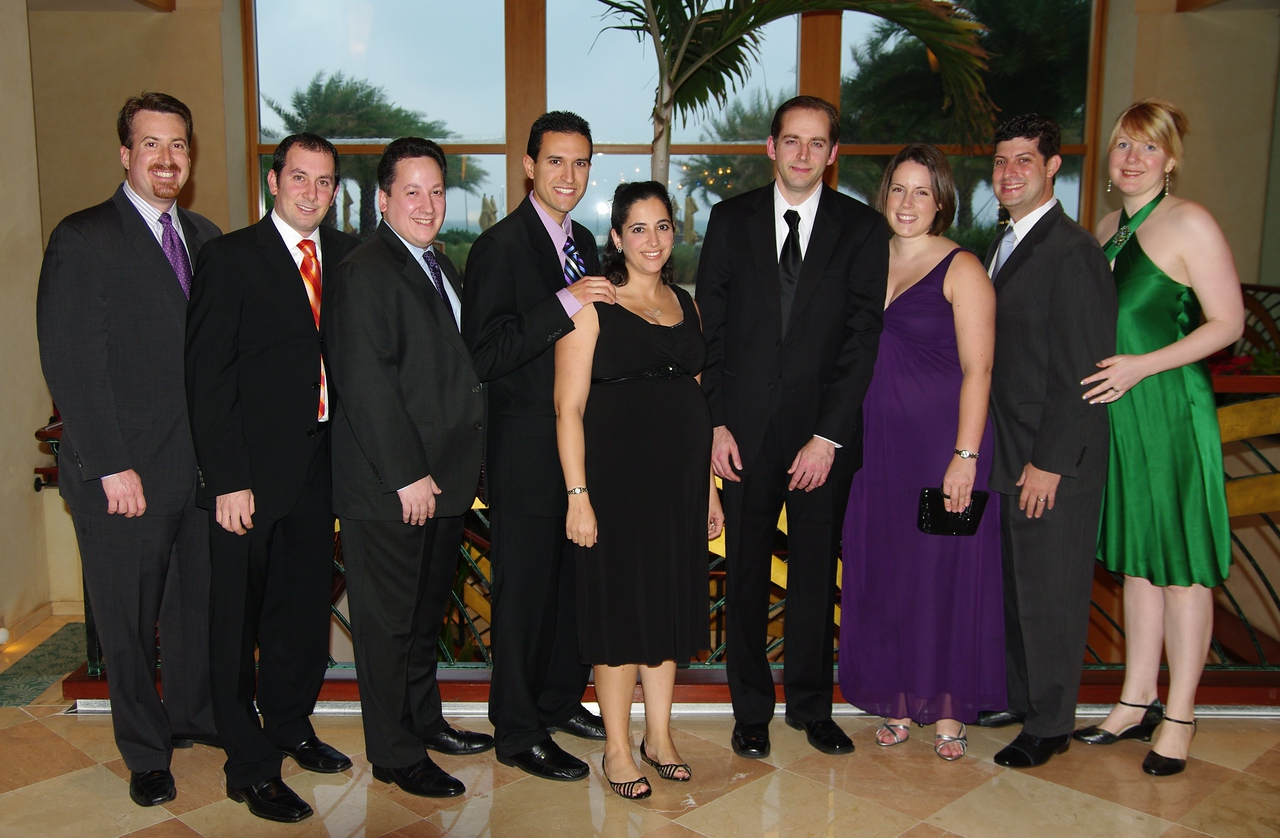 Six of the fraternity brothers at the event along with a few significant others