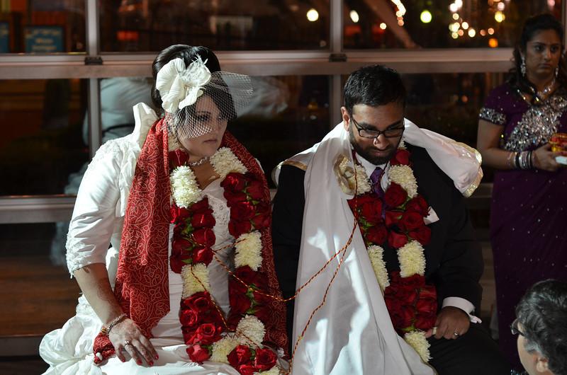 Amar & Nicole during the ceremony.