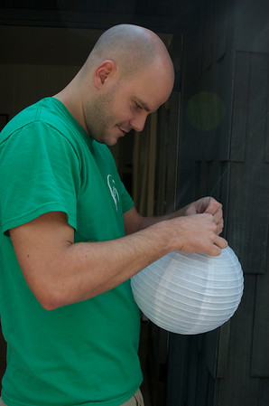 Steve tying lights into lanterns
