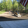 The heavy equipment was brought in to get the gravel driveway ready for the big event.