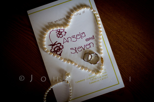 wedding program and pearls